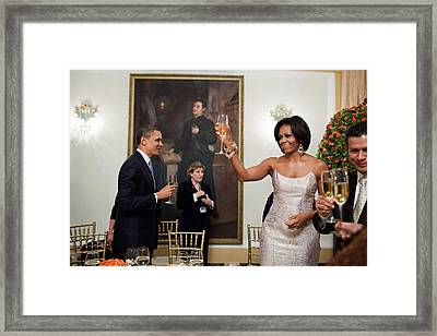President And Michelle Obama Toast Framed Print