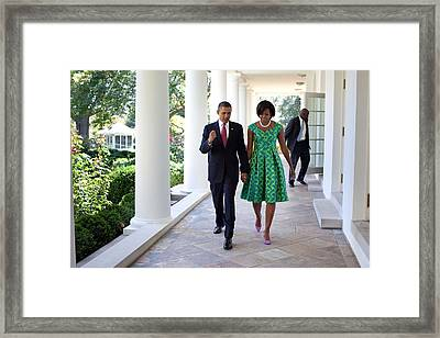 President And Michelle Obama Walk Framed Print by Everett