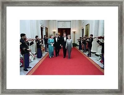 President And Nancy Reagan Walking Framed Print by Everett