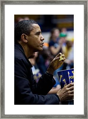 President Barack Obama Eats Popcorn Framed Print by Everett