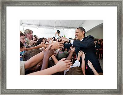 President Barack Obama Greets Young Framed Print by Everett