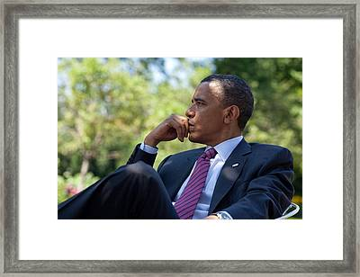 President Barack Obama Is Briefed Framed Print