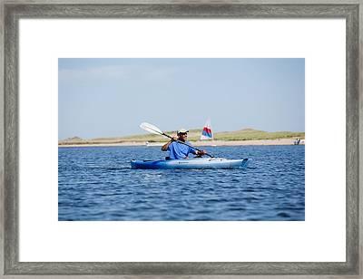President Barack Obama Kayaks While Framed Print by Everett