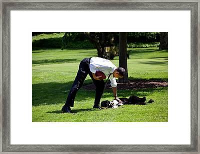 President Barack Obama Pets The Family Framed Print by Everett