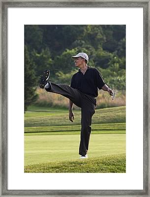 President Barack Obama Puts A Little Framed Print by Everett