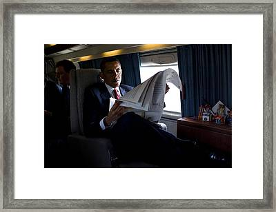 President Barack Obama Reading Framed Print by Everett