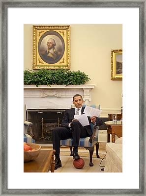 President Barack Obama Rests His Foot Framed Print by Everett