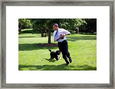 President Barack Obama Runs Away Framed Print by Everett