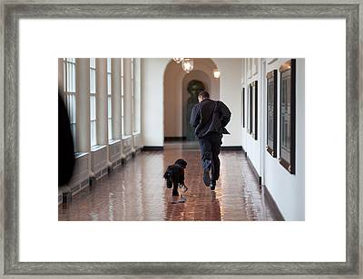 President Barack Obama Runs Framed Print by Everett