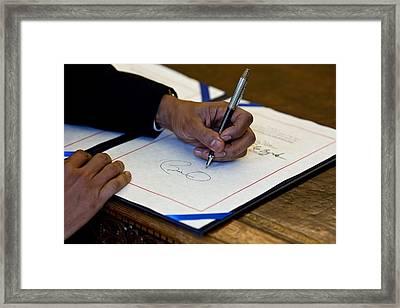 President Barack Obama Signs A Bill Framed Print