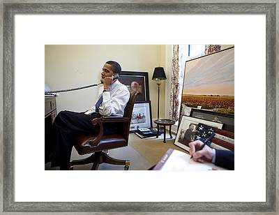 President Barack Obama Takes A Phone Framed Print by Everett