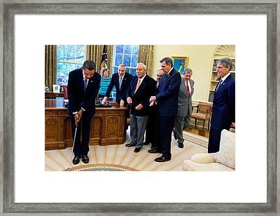 President Barack Obama Takes A Practice Framed Print by Everett