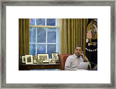 President Barack Obama Talks Framed Print by Everett