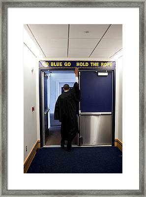 President Barack Obama Touches The Sign Framed Print
