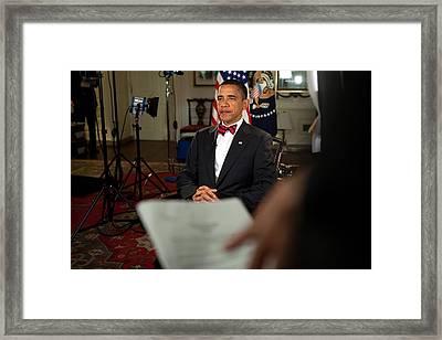 President Barack Obama Wearing A Bow Framed Print by Everett