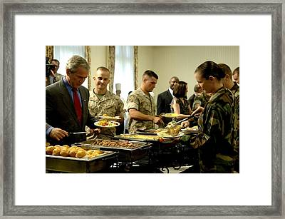 President Bush And Soldiers Fill Framed Print