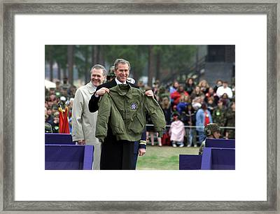 President Bush Displays A Jacket Given Framed Print by Everett
