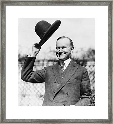 President Calvin Coolidge Tips Is Hat Framed Print by International  Images