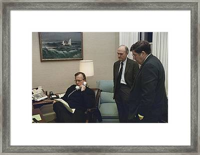 President George Bush In A Telephone Framed Print by Everett