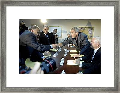 President George W. Bush Shakes Hands Framed Print by Everett