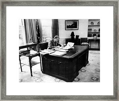 President Jimmy Carter At Work Framed Print by Everett