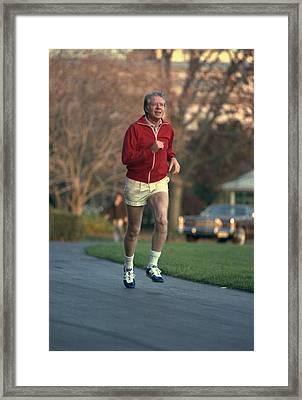 President Jimmy Carter Jogging. Nov. 20 Framed Print by Everett