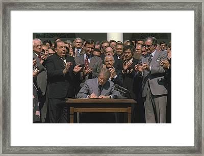 President Jimmy Carter Signing Public Framed Print by Everett