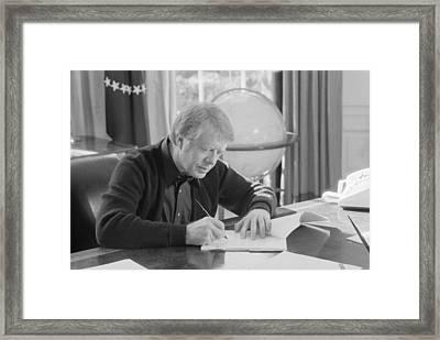 President Jimmy Carter Working Framed Print by Everett