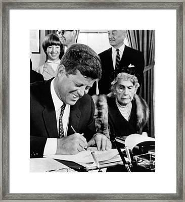 President John Kennedy Signs A Joint Framed Print by Everett