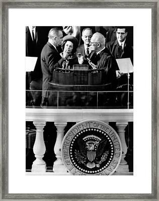 President Johnson Takes The Oath Framed Print by Everett