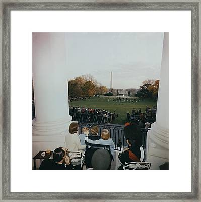 President Kennedy And His Family Watch Framed Print