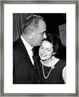 President Lyndon Johnson Kisses Framed Print by Everett