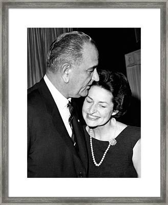 President Lyndon Johnson Kisses Framed Print by Everett