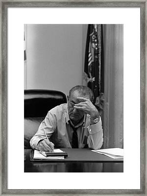 President Lyndon Johnson Making Notes Framed Print by Everett