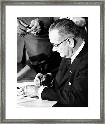 President Lyndon Johnson Signing Framed Print by Everett