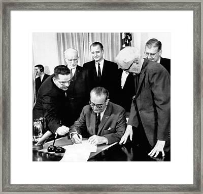 President Lyndon Johnson Signs The 24th Framed Print by Everett