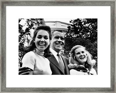President Nixon Poses With His Two Framed Print by Everett