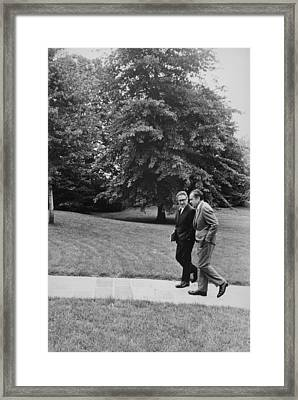 President Nixon Walking With Kissinger Framed Print by Everett
