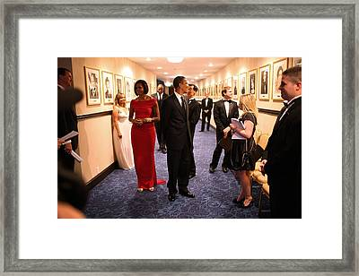 President Obama And Michelle Obama Wait Framed Print by Everett