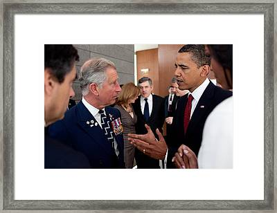President Obama And Prince Charles Talk Framed Print by Everett