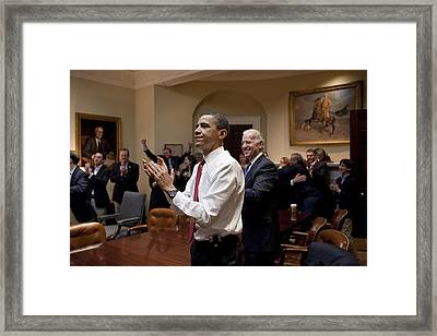 President Obama And Vp Biden Applaud Framed Print by Everett