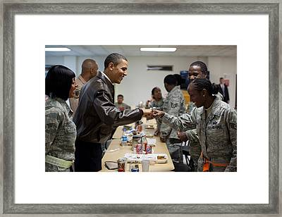 President Obama Greets A Female Soldier Framed Print by Everett
