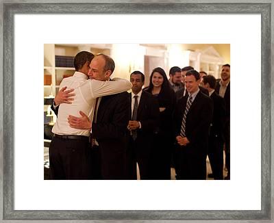 President Obama Hugs Phil Schiliro Framed Print by Everett