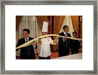 President Obama In A Noodle-making Framed Print