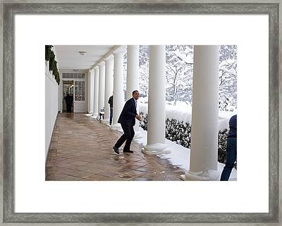 President Obama In A Snowball Fight Framed Print by Everett