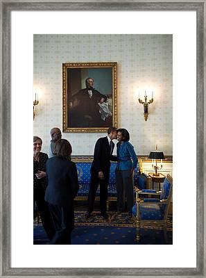President Obama Kisses First Lady Framed Print
