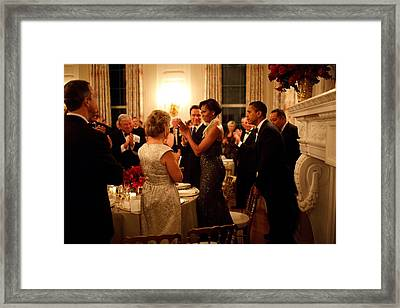 President Obama Pulls Out The Chair Framed Print by Everett