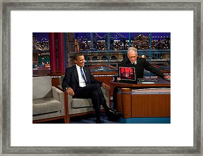 President Obama Reacts To A Photograph Framed Print by Everett