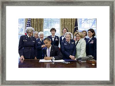 President Obama Signs A Bill To Award Framed Print by Everett