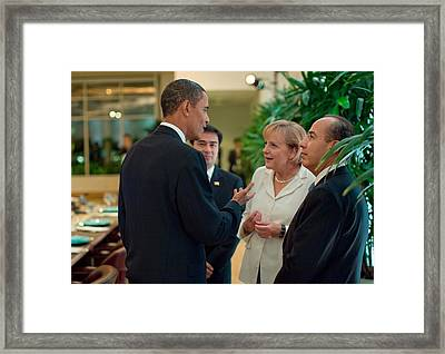 President Obama Talks With German Framed Print by Everett